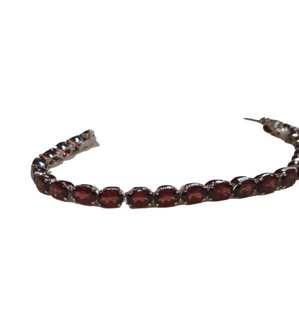 Silver bracelet with garnet stones
