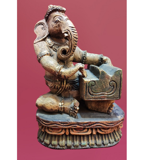 Ganesha Playing Musical Instrument Handcrafted In Vaghai Wood